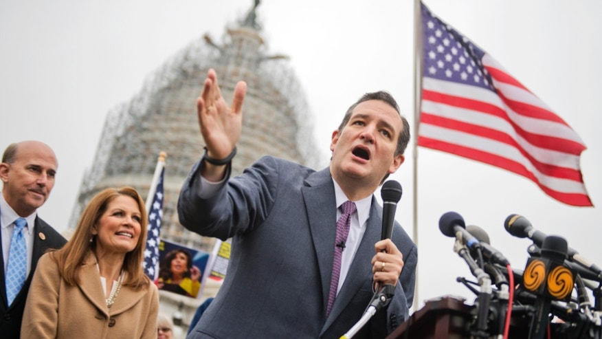 UNITED STATES - DECEMBER 03: Sen. Ted Cruz, R-Texas, speaks at the podium as Reps. Louie Gohmert, R-Texas, and Michelle Bachmann, R-Minn., look on, during a rally on the east front lawn of the Capitol to call for the defunding of President Obama's executive action that gives a temporary reprieve to undocumented immigrants.