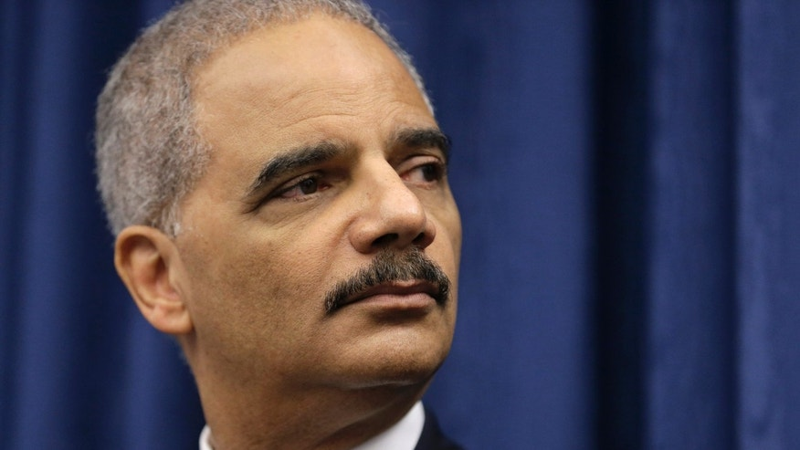Dec. 4, 2014: U. S. Attorney General Eric Holder speaks during a news conference before a roundtable meeting in Cleveland.