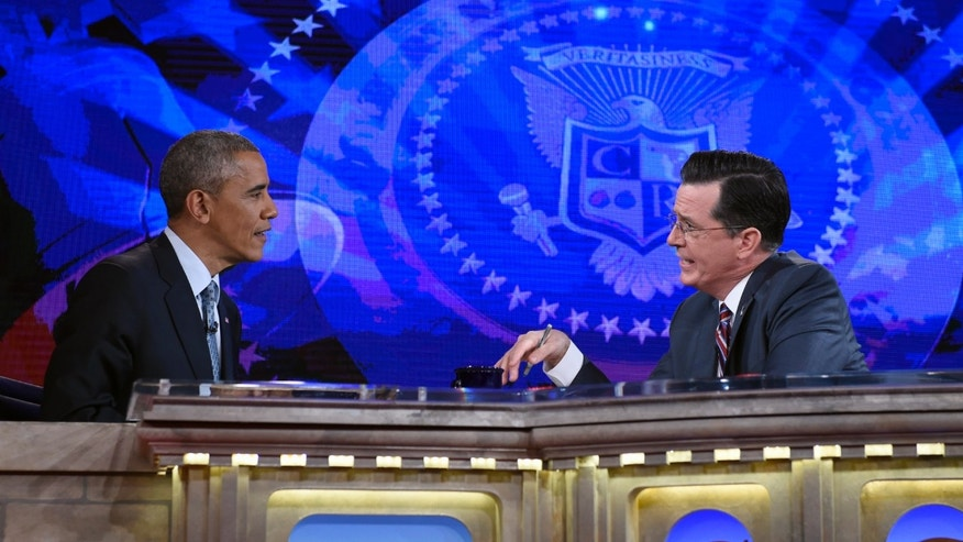 Dec. 8, 2014: President Barack Obama talks with Stephen Colbert of The Colbert Report during a taping of the program in Lisner Auditorium at George Washington University.