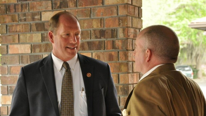 Rep. Ted Yoho, R-Florida, speaking with a constituent.