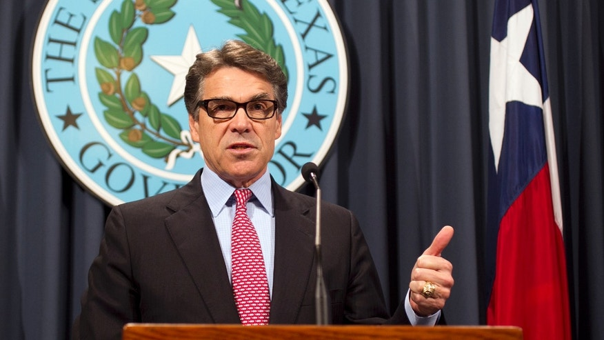 Texas Gov. Rick Perry speaks during a news conference on Wednesday, Dec. 3, 2014 at the Capitol in Austin.