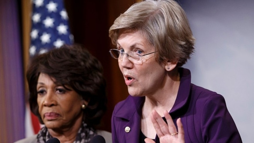 Dec. 10, 2014: Sen. Elizabeth Warren, D-Mass., a member of the Senate Banking Committee, right, and Rep. Maxine Waters, D-Calif., ranking member of the House Financial Services Committee, express their outrage to reporters that a huge, $1.1 trillion spending bill approved by the Republican-controlled House yesterday contains changes to the 2010 Dodd-Frank law that regulates complex financial instruments known as derivatives.