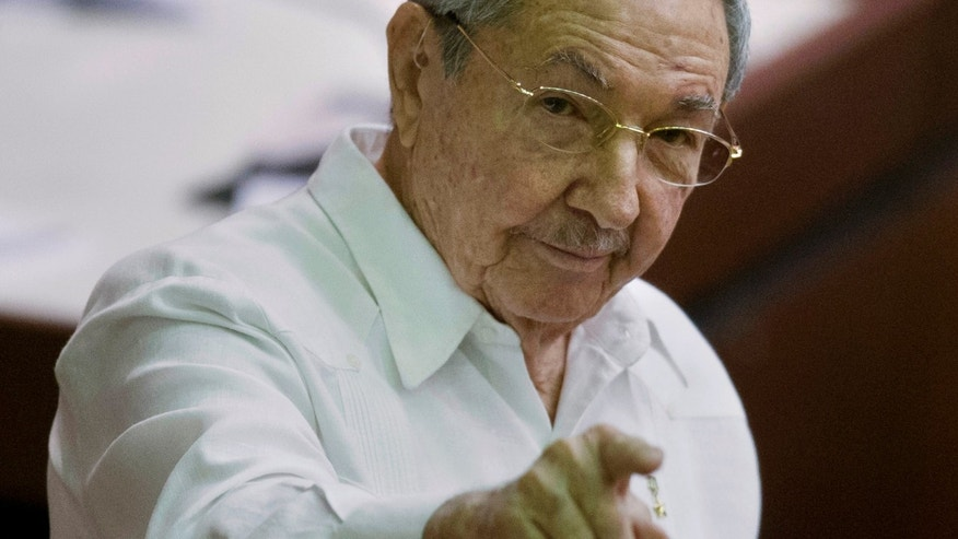 Cuba's President Raul Castro points to the press during the closing of the legislative session at the National Assembly in Havana, Cuba, Saturday, Dec. 20, 2014. While praising the historic agreement between Cuba and the U.S. to restore relations, Castro made it clear that the agreement only goes so far, reminding the audience of his call for the U.S. Congress to end the trade embargo. (AP Photo/Ramon Espinosa)
