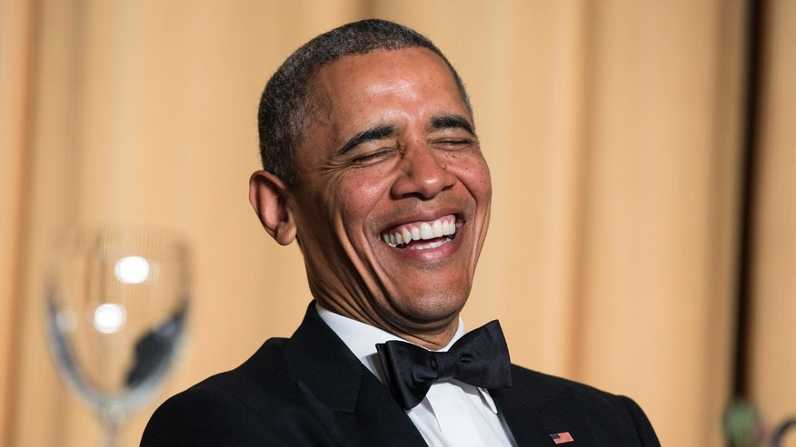 President Barack Obama laughs at a joke during the White House Correspondents' Association Dinner in Washington May 3, 2014. (REUTERS/Joshua Roberts)