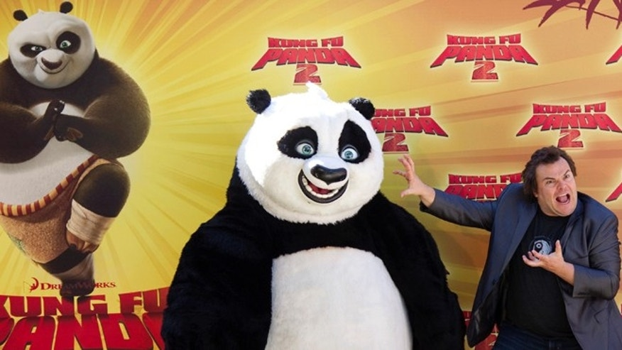 June 10, 2011: Actor Jack Black poses with a costumed 'Kung Fu Panda' at a promotional event in Madrid.