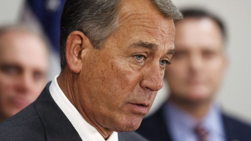 Speaker of the House John Boehner answers a question during a news conference on Capitol Hill, in Washington December 10, 2014.  REUTERS/Larry Downing