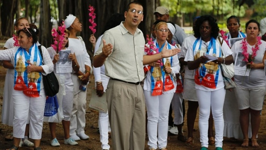 Cuban dissident Antonio Rodiles speaks during a gathering of Cuba's dissident group Ladies in White in Havana, Cuba, Sunday Dec. 28, 2014. Cubaâs government has long narrowly defined the bounds of acceptable speech, accusing many dissidents of being as agents of the U.S. government or right-wing exile groups, and subjecting them to surveillance, temporary detention and harassment. Advocates of a softer line usually receive less harsh treatment. (AP Photo/Desmond Boylan)