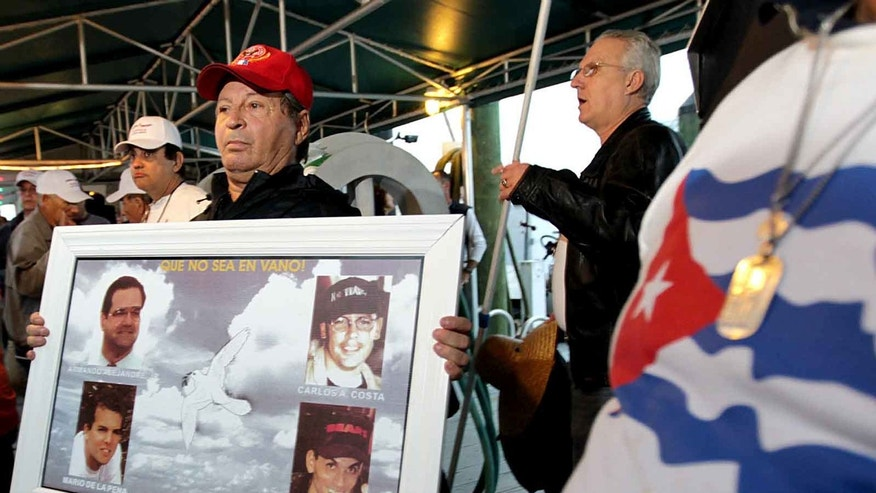 "Nelson Morales, brother of Pablo Morales, pays tribute to Brothers to Rescue, who died when their planes were shot down by Cuban jets on international waters in 1996, before a group of Cuban exiles depart in a flotilla of  boats staging a fireworks show a little more than 12 miles off the coast of Havana named The ""Lights of Liberty"" show, Friday, Dec. 9, 2011, in Key West, Fla. The event is organized by the Miami-based Democracy Movement. (AP Photo/El Nuevo Herald, Pedro Portal) MAGS OUT"