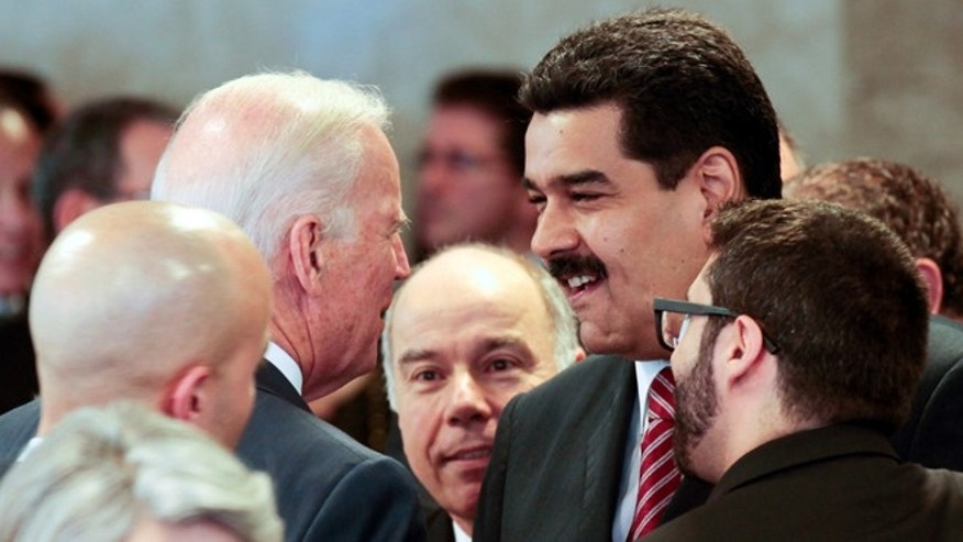 In this photo provided by Miraflores presidential press office, Venezuela's President Nicolas Maduro, right, speaks with U.S. Vice President Joe Biden on the sidelines of the swearing-in ceremony of Brazil's reelected President Dilma Rousseff in Brasilia, Brazil, Jan. 1, 2015. The meeting came two weeks after President Barack Obama signed legislation to impose sanctions on Venezuelan officials accused of violating human rights. Last week, Maduro accused the U.S. of waging a war to destroy the South American countrys socialist revolution. (AP Photo/Miguel Angulo, Miraflores Presidential Office)