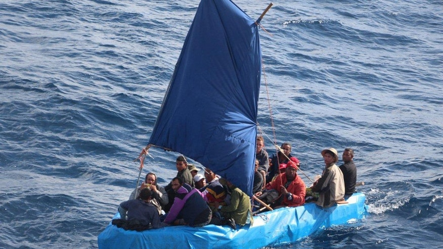 This Jan. 1, 2015 photo provided by the U.S. Coast Guard shows 24 Cuban migrants in the waters south of Key West, Fla. The Cubans were later repatriated. Coast Guard officials said Monday, Jan. 5, 2015, that the number of Cubans attempting to reach Florida illegally by sea has surged since the U.S. and Cuba announced they would restore diplomatic relations. (AP Photo/U.S. Coast Guard)