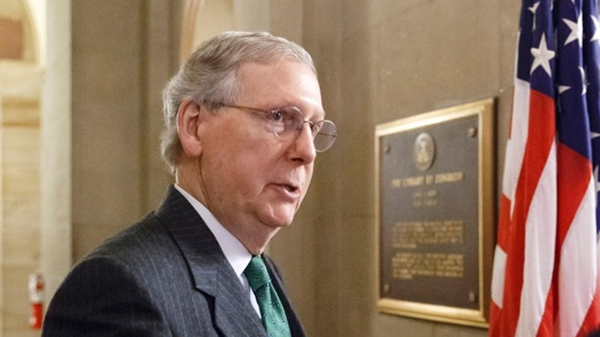 Monday, Jan. 5, 2015 photo of incoming Senate Majority Leader Mitch McConnell of Ky. outside his office on Capitol Hill in Washington.