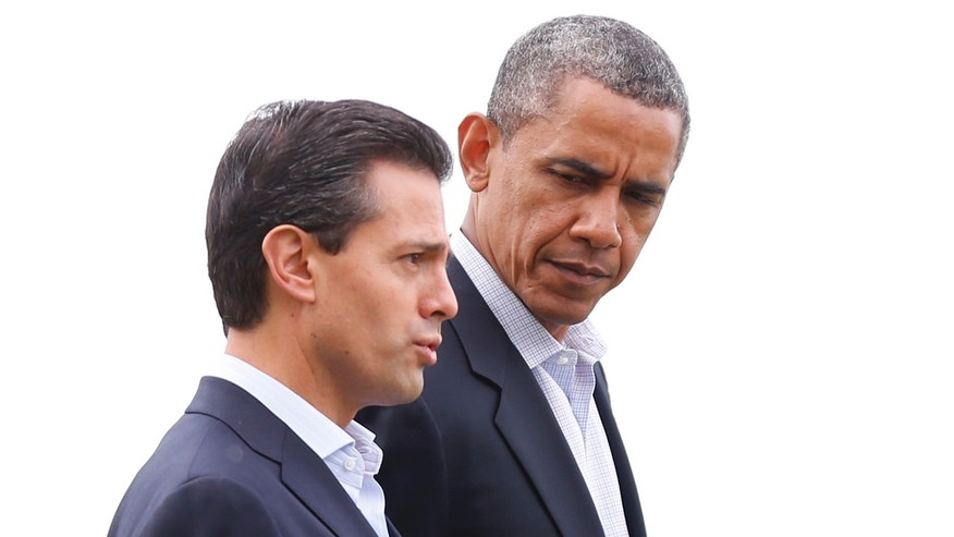 US President Barack Obama, right, speaks with Mexican President Enrique Pena Nieto during arrivals for a lunch event at the G-8 summit at the Lough Erne golf resort in Enniskillen, Northern Ireland, on Tuesday, June 18, 2013. The final day of the G-8 summit of wealthy nations is ending with discussions on globe-trotting corporate tax dodgers, a lunch with leaders from Africa, and suspense over whether Russia and Western leaders can avoid diplomatic fireworks over their deadlock on Syriaâs civil war. (AP Photo/Matt Dunham)