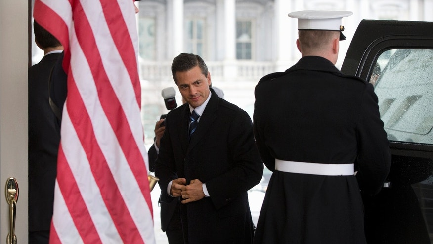 Mexico's President Enrique Pena Nieto at the White House in Washington, Tuesday, Jan. 6, 2015, for meetings with President Barack Obama. Obama is looking to his southern neighbor for help implementing the changing policies on immigration and Cuba. (AP Photo/Carolyn Kaster)