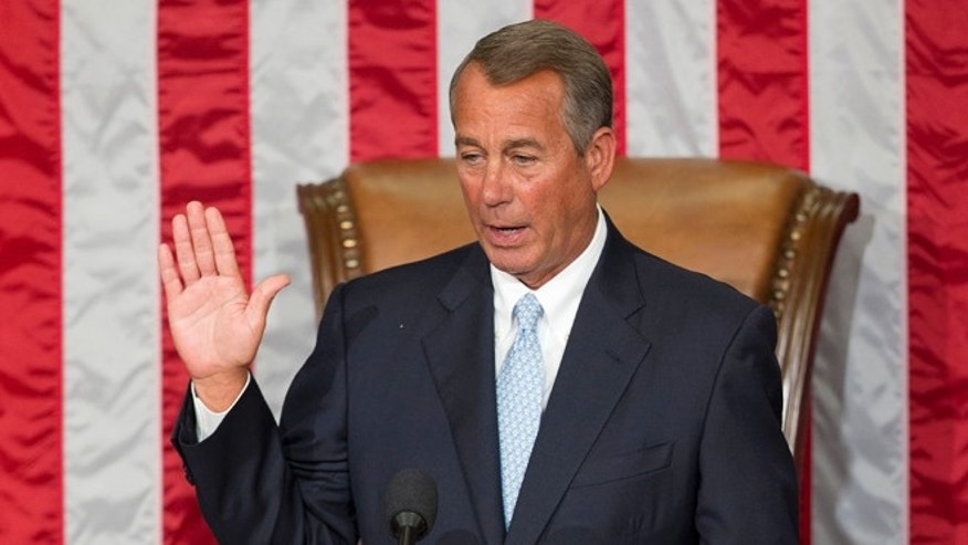 In this Tuesday, Jan. 6, 2015 photo House Speaker John Boehner of Ohio takes the oath of office after being re-elected to a third term during the opening session of the 114th Congress.