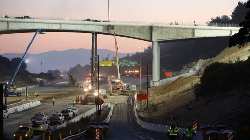 FILE: 2011: Workers demolish the Mulholland Drive bridge across the 405 freeway in Los Angeles, Calif.