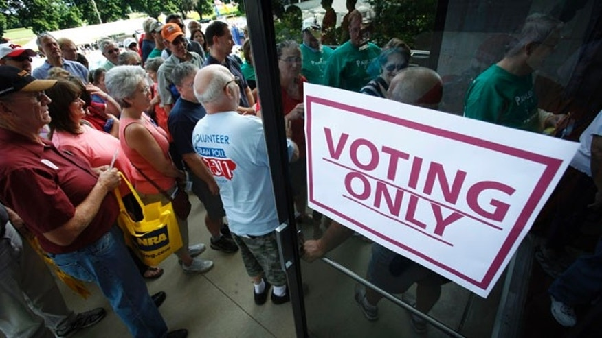 FILE: Aug. 13, 2011: Republicans enter Hilton Coliseum before casting their ballots in the Iowa Republican Part's straw poll, in Ames, Iowa.