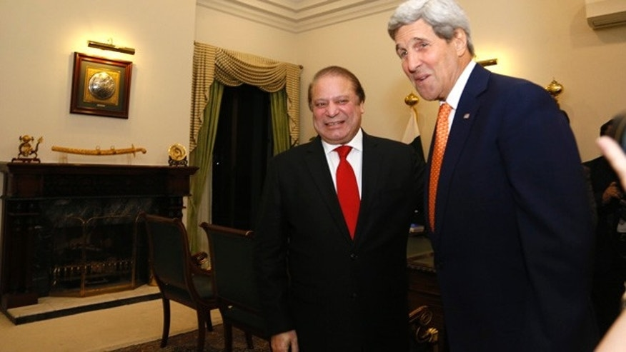Jan. 12, 2015: U.S. Secretary of State John Kerry is greeted by Pakistan Prime Minister Nawaz Sharif shortly after arriving in Islamabad. (AP Photo/Rick Wilking, Pool)