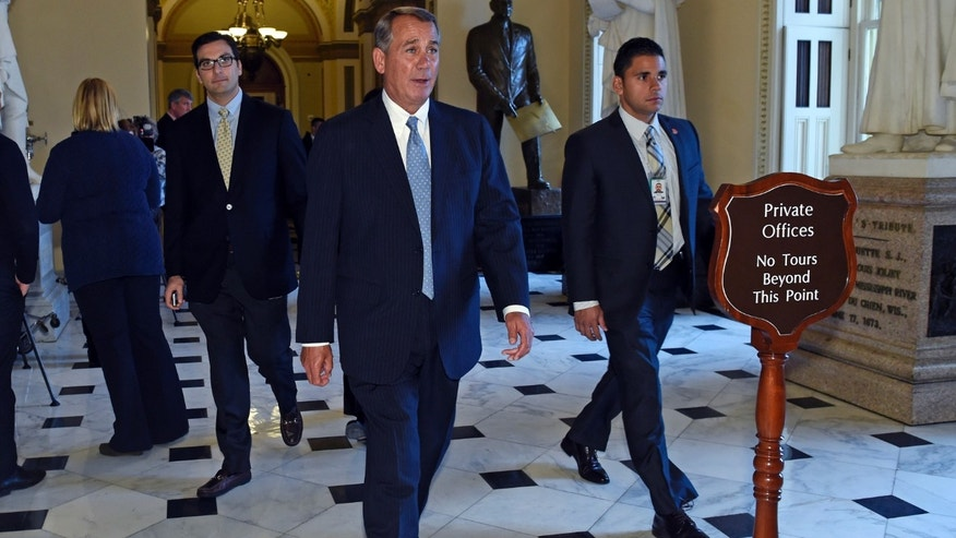 House Speaker John Boehner of Ohio walks back to his office on Capitol, Wednesday, Jan. 14, 2015.