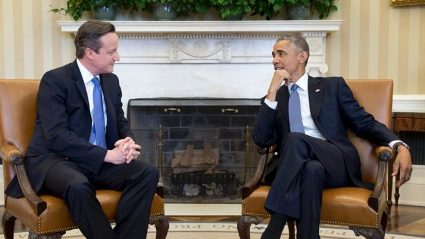 President Barack Obama meets with British Prime Minister David Cameron, Friday, Jan. 16, 2015, in the Oval Office of the White House in Washington.