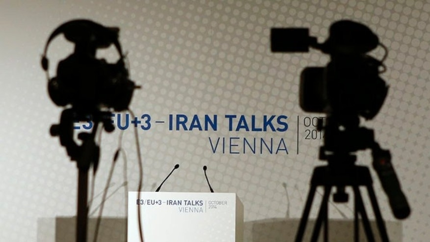 FILE: Oct. 14, 2014: Video cameras at a news conference between EU foreign policy chief Catherine Ashton and Iranian Foreign Minister Mohammad Javad Zarif, in Vienna.