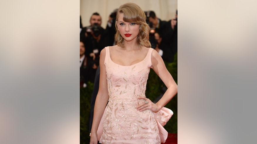 Musician Taylor Swift attends the 'Charles James: Beyond Fashion' Costume Institute Gala at the Metropolitan Museum of Art on May 5, 2014 in New York City. (Photo by Dimitrios Kambouris/Getty Images)