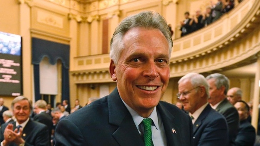 In this Wednesday, Jan. 14, 2015 photo Virginia Gov. Terry McAuliffe leaves the chambers after delivering his annual State of the Commonwealth address at the Capitol in Richmond, Va.