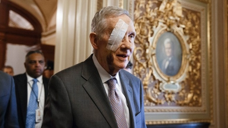 Senate Minority Leader Harry Reid of Nev. returns to Capitol Hill in Washington, Tuesday, Jan. 20, 2015, for the first time since suffering injuries after an exercise accident.