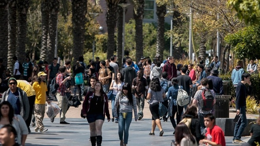 This April 4, 2012 file photo shows students on campus at Santa Monica College in Santa Monica, California.