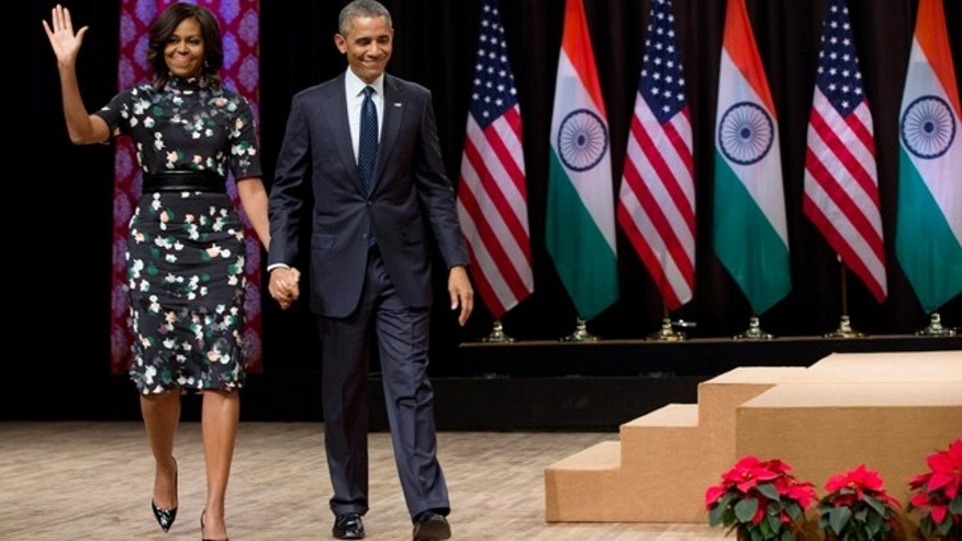Jan. 27, 2015: President Barack Obama walks from the stage with first lady Michelle Obama after his speech at the Siri Fort Auditorium in New Delhi, India. (AP Photo/Carolyn Kaster)