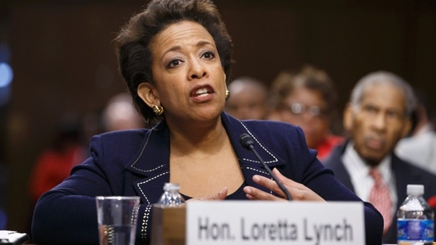 Attorney General nominee Loretta Lynch testifies on Capitol Hill in Washington, Wednesday, Jan. 28, 2015, before the Senate Judiciary Committee's hearing on her nomination. Lynch defended President Barack Obama's decision to shelter millions of immigrants from deportation though they live in the country illegally but she said they have no right to citizenship under the law. If confirmed, Lynch would become the nation's first black female attorney general. It is the first confirmation proceeding since Republicans took control of the Senate this month.   (AP Photo/J. Scott Applewhite)