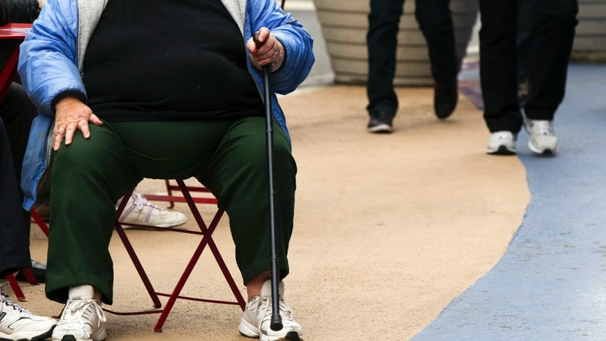 An overweight woman sits on a chair in Times Square in New York, May 8, 2012.(REUTERS/Lucas Jackson)