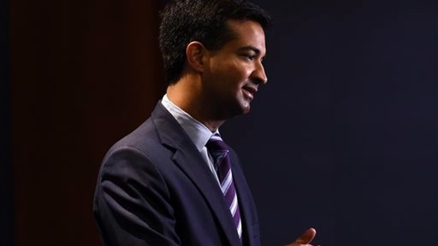 FILE - In this Nov. 13, 2014 fil photo, Rep.-elect Carlos Curbelo, R-Fla., does a television interview on Capitol Hill in Washington. (AP Photo/Susan Walsh, File)