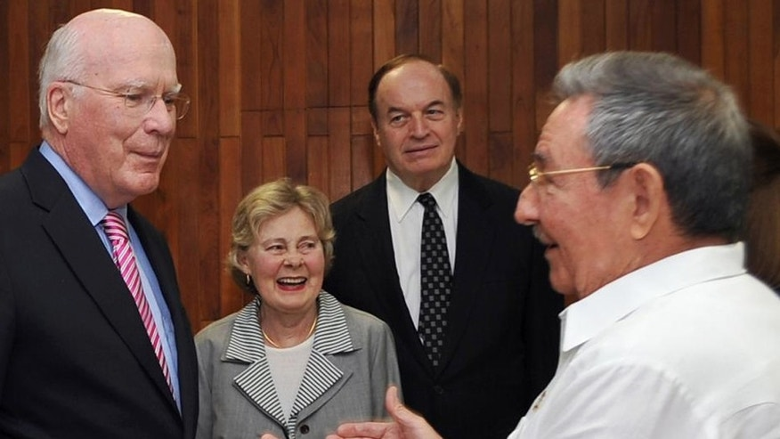 In this photo released by Cuba's state-run Granma newspaper, Cuba's President Raul Castro, right, speaks with U.S. Sen. Patrick Leahy, left, a Democrat from Vermont, as U.S. Senator Richard Shelby, a Republican from Alabama, behind right, watches in Havana, Cuba, Thursday Feb. 23, 2012.  Senator Leahy says he met with imprisoned American Alan Gross and discussed the man's case with Raul Castro, but that no release was likely any time soon. The woman at center is unidentified. (AP Photo/Geovani Fernandez, Granma)