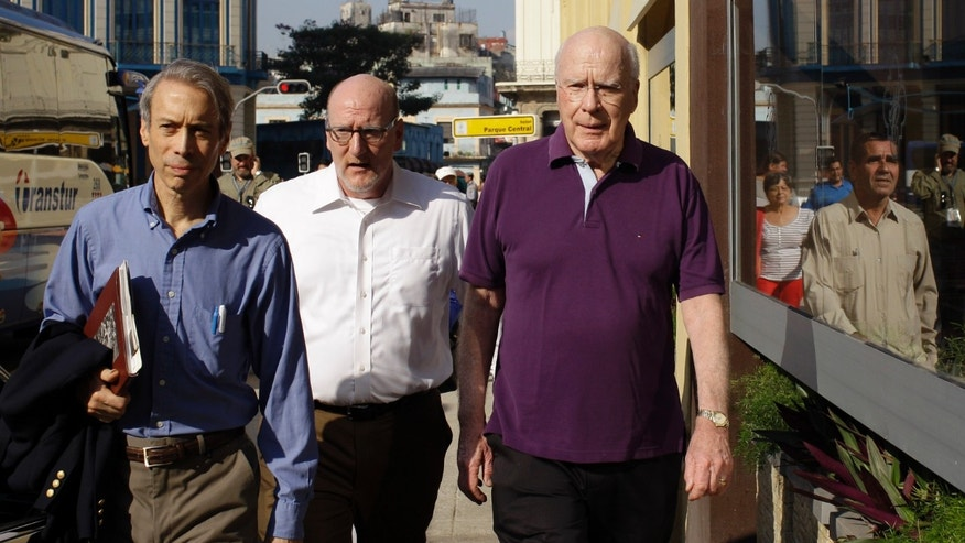 U.S. Sen. Patrick Leahy, right, arrives to the Hotel Parque Central along with two unidentified men in Havana, Cuba.