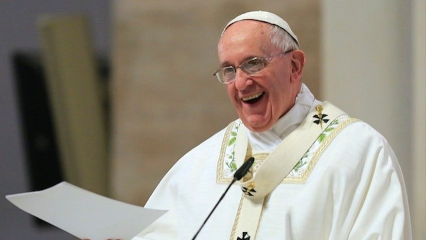 "Pope Francis smiles as he delivers his messages during a mass at the Cathedral church in Manila January 16, 2015. Pope Francis called on the Philippine government on Friday to tackle corruption and hear the cries of the poor suffering from ""scandalous social inequalities"" in Asia's most Catholic country. Pope Francis arrived in Manila on Thursday for a five-day visit.  REUTERS/Romeo Ranoco  (PHILIPPINES - Tags: POLITICS RELIGION SOCIETY) - RTR4LMZU"