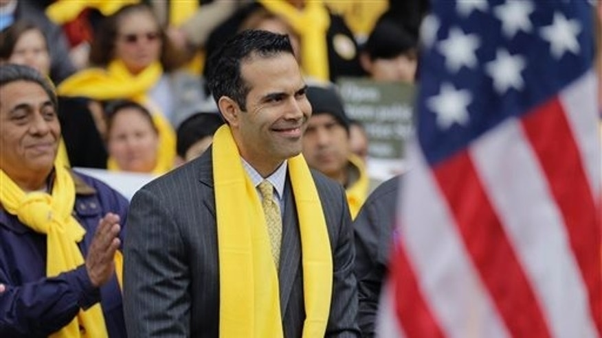 Texas Land Commissioner George P. Bush  takes part in a school choice rally at the Texas Capitol, Friday, Jan. 30, 2015, in Austin, Texas. School choice supporters called for expanding voucher programs and charter schools statewide. (AP Photo/Eric Gay)