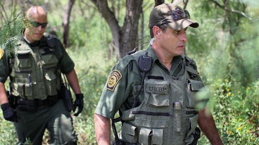 MCALLEN, TX - MAY 27:  Border Patrol agents Robert Sanchez (L) and Hugo Moya search for undocumented immigrants believed to be hiding in the area along the north shore of the Rio Grande River which forms the border between the U.S. and Mexico May 27, 2010 near McAllen, Texas. During the 2009 fiscal year, 540,865 undocumented immigrants were apprehended entering the U.S. along the Mexican border.  (Photo by Scott Olson/Getty Images) *** Local Caption *** Hugo Moya;Robert Sanchez