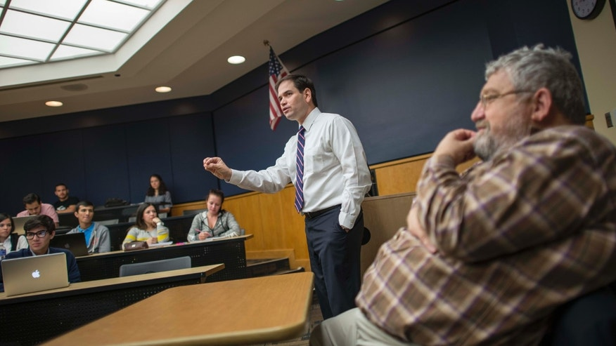 MIAMI, FL - FEBRUARY 9: Day in the life of Senator Marco Rubio on February 9, 2015 in Miami, Florida. Senator Rubio and his co professor, Dario Moreno (R) teach political science to their class at Florida International University. (Photos by Charles Ommanney for the Washington Post)