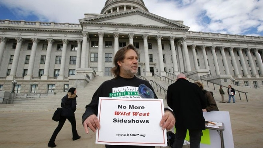 Jan. 27, 2015: Randy Gardner of Salt Lake City, the older brother of Ronnie Lee Gardner, the last inmate to be killed by firing squad in Utah in 2010, protests with a group opposed to capital punishment plans.