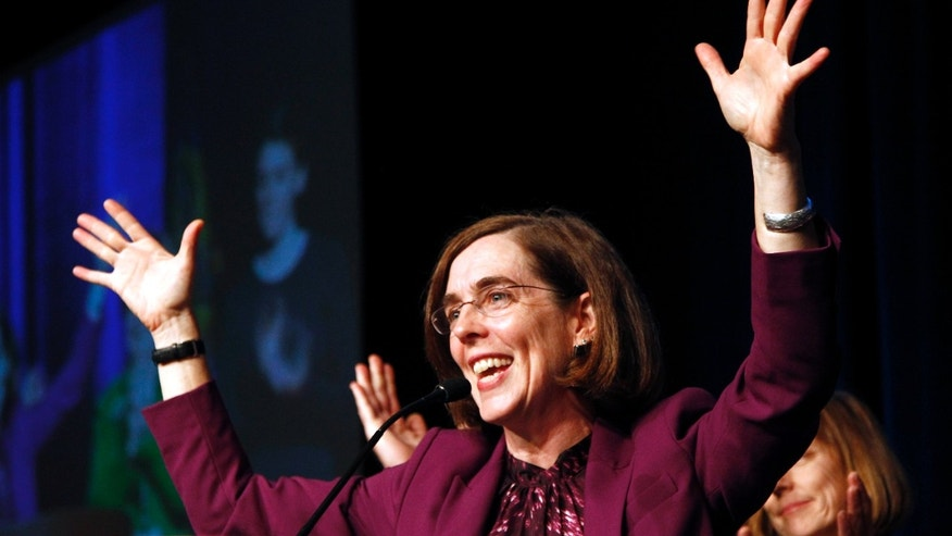 Nov. 6, 2012: Oregon Democratic Secretary of State Kate Brown celebrates at the podium after winning her race at Democratic headquarters.