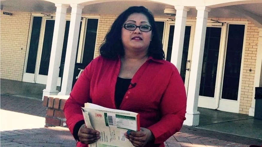 Nancy Perez, who qualifies for President Barack Obama's deportation relief plan, holds documents she was planning to use for her application for the program.
