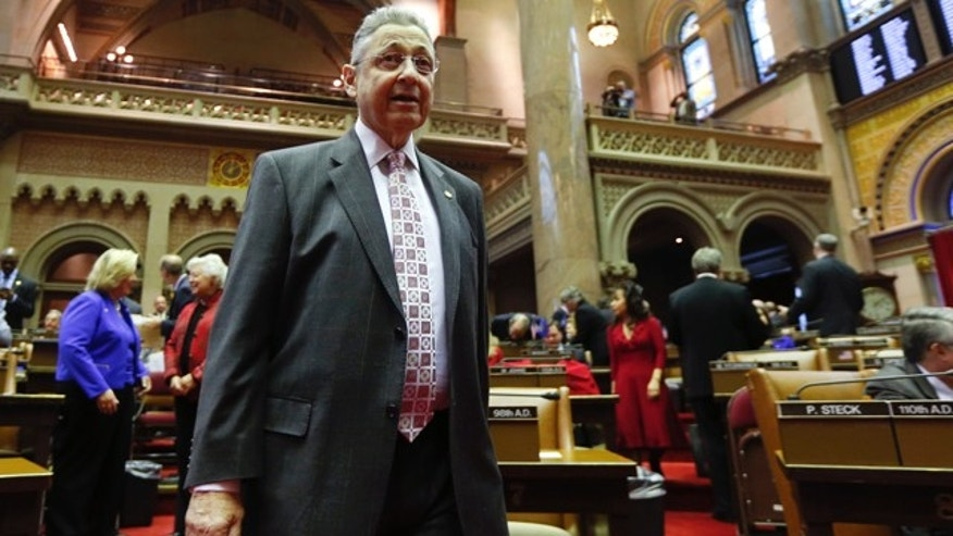 Jan. 7, 2015: Assembly Speaker Sheldon Silver, D-Manhattan, walks on the floor in the Assembly Chamber at the start of the 2015 legislative session at the state Capitol in Albany, N.Y. (AP Photo/Mike Groll)