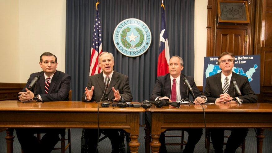 From left to right, Texas Sen. Ted Cruz, Gov. Greg Abbott, Attorney General Ken Paxton and Lt. Gov. Dan Patrick talk about President Obama's immigration executive order at a news conference at the Capitol in Austin, Texas, Wednesday, Feb. 18, 2015. (AP Photo/Austin American-Statesman, Jay Janner) AUSTIN CHRONICLE OUT; COMMUNITY IMPACT OUT; INTERNET AND TV MUST CREDIT PHOTOGRAPHER AND STATESMAN.COM; MAGAZINES OUT