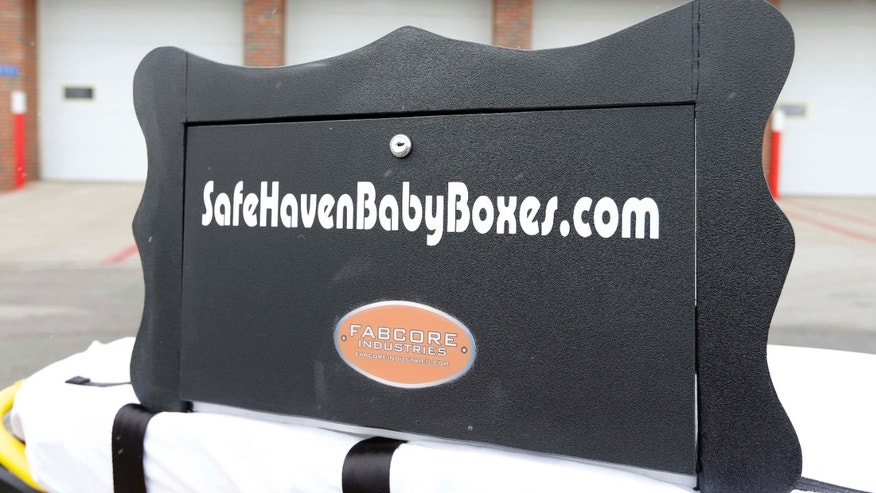 Feb. 26, 2015: A prototype of a baby box, where parents could surrender their newborns anonymously, is shown outside the fire station in Woodburn, Ind.