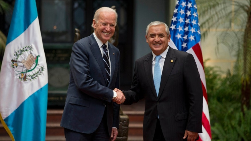 U.S. Vice President Joe Biden, left, shakes hands with Guatemalaâs President Otto Perez Molina during a photo opportunity at the National Palace in Guatemala City, Monday, March 2, 2015. Joe Biden is starting a two day trip to meet with the leaders of Guatemala, El Salvador and Honduras regarding immigration issues. (AP Photo/Moises Castillo)
