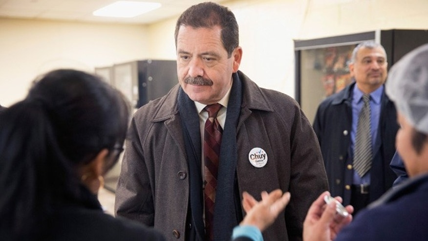 "CHICAGO, IL - FEBRUARY 23:  Chicago Mayoral candidate Jesus ""Chuy"" Garcia greets workers during a campaign stop at a linen and uniform service company on February 23, 2015 in Chicago, Illinois. Recent polls show Garcia is running second to incumbent Mayor Rahm Emanuel whose lead is not currently large enough to avoid a runoff election. Chicago residents go to the polls Tuesday, February 24.  (Photo by Scott Olson/Getty Images)"
