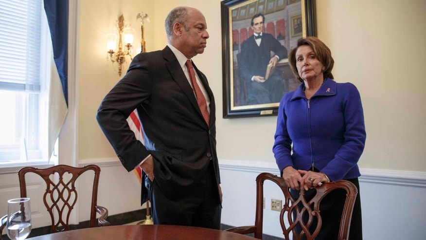Homeland Security Secretary Jeh Johnson, left, meets with House Minority Leader Nancy Pelosi, D-Calif.