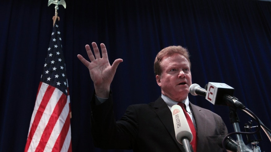 Sen. Jim Webb talks to reporters during his news conference at the U.S. embassy in Yangon, April 11, 2012. (REUTERS/Soe Zeya Tun)