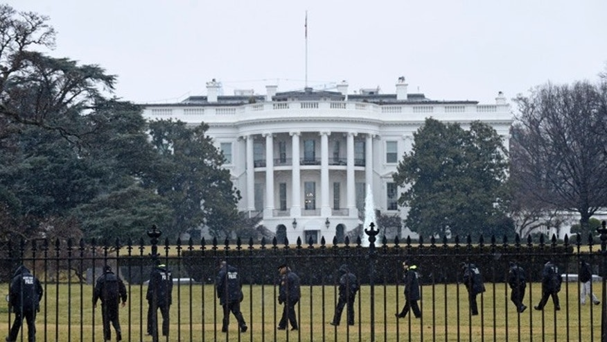 FILE - In this Jan. 26, 2015 file photo, Secret Service officers search the south grounds of the White House in Washington after an unmanned aerial drone was found on the White House grounds during the middle of the night. (AP Photo/Susan Walsh, File)