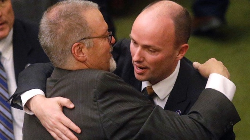 March 11, 2015: Sen. Stephen Urquhart, left, R-St. George, embraces Lt. Gov. Spencer J. Cox after the Republican-controlled Utah Legislature passed an anti-discrimination bill. (AP Photo/Rick Bowmer)